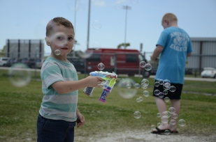 Rhys Prettyman, 2, scattered bubbles in the air while waiting for the egg hunt. The hunt was part of Sarasota County's annual Big Truck Day EGGstravaganza, which allows children the chance to explore the county's biggest equipment while showing parents what their tax dollars are funding. From fire trucks and police patrol cars to tractors and semis, kids could climb up, honk the horns and blow the sirens to their heart's content.